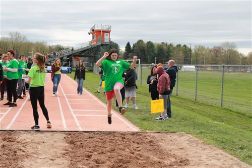 Fulton students participate in long jump event during olympiad