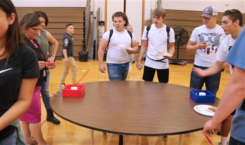 students play a game with high school principal